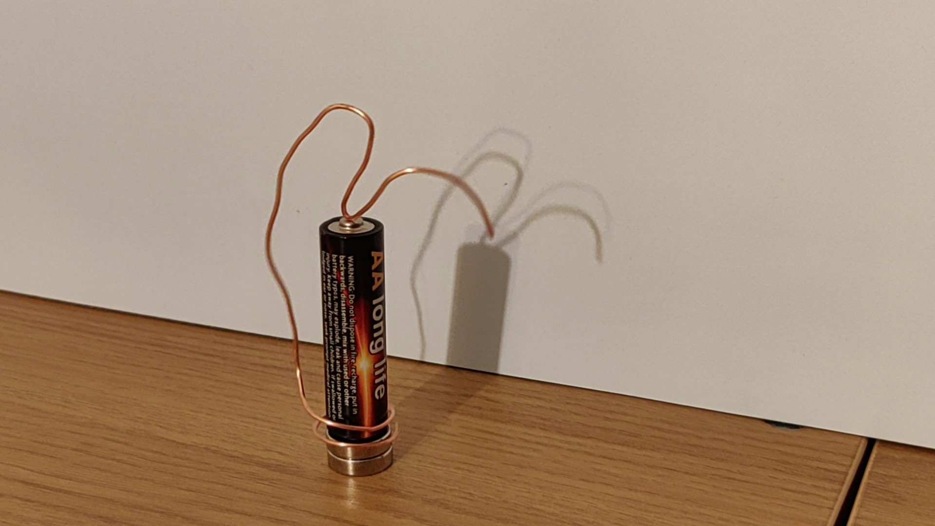 make this homopolar motor with a battery some wire and a strong magnet